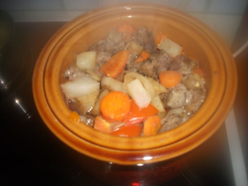 slow cooker lamb stew in vintage slow cooker