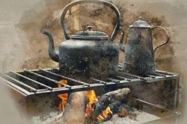 old time tea kettles and coffee pot on the range