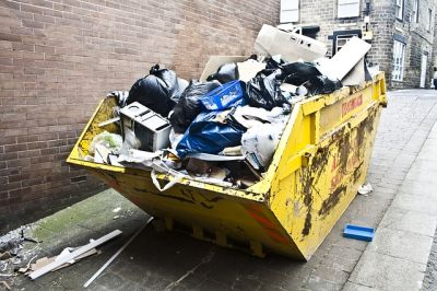 steam generator irons a rubbish skip full of busted houshold appliances